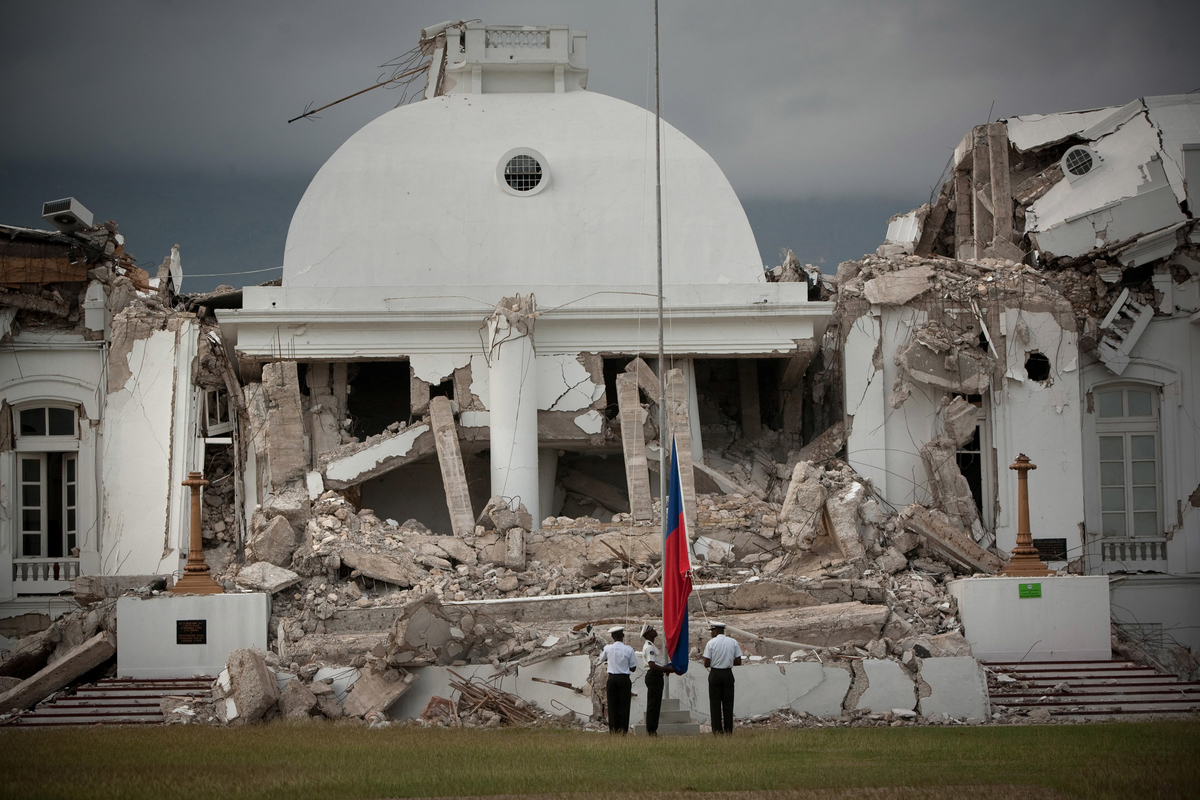still fissured s health system five years after the officials raise the an flag in front of the destroyed national palace in downtown port au prince before a band plays the national anthem the