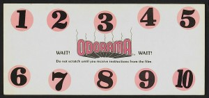 The Odorama card instructs audience members to wait for a corresponding flashing number on screen before scratching and sniffing.